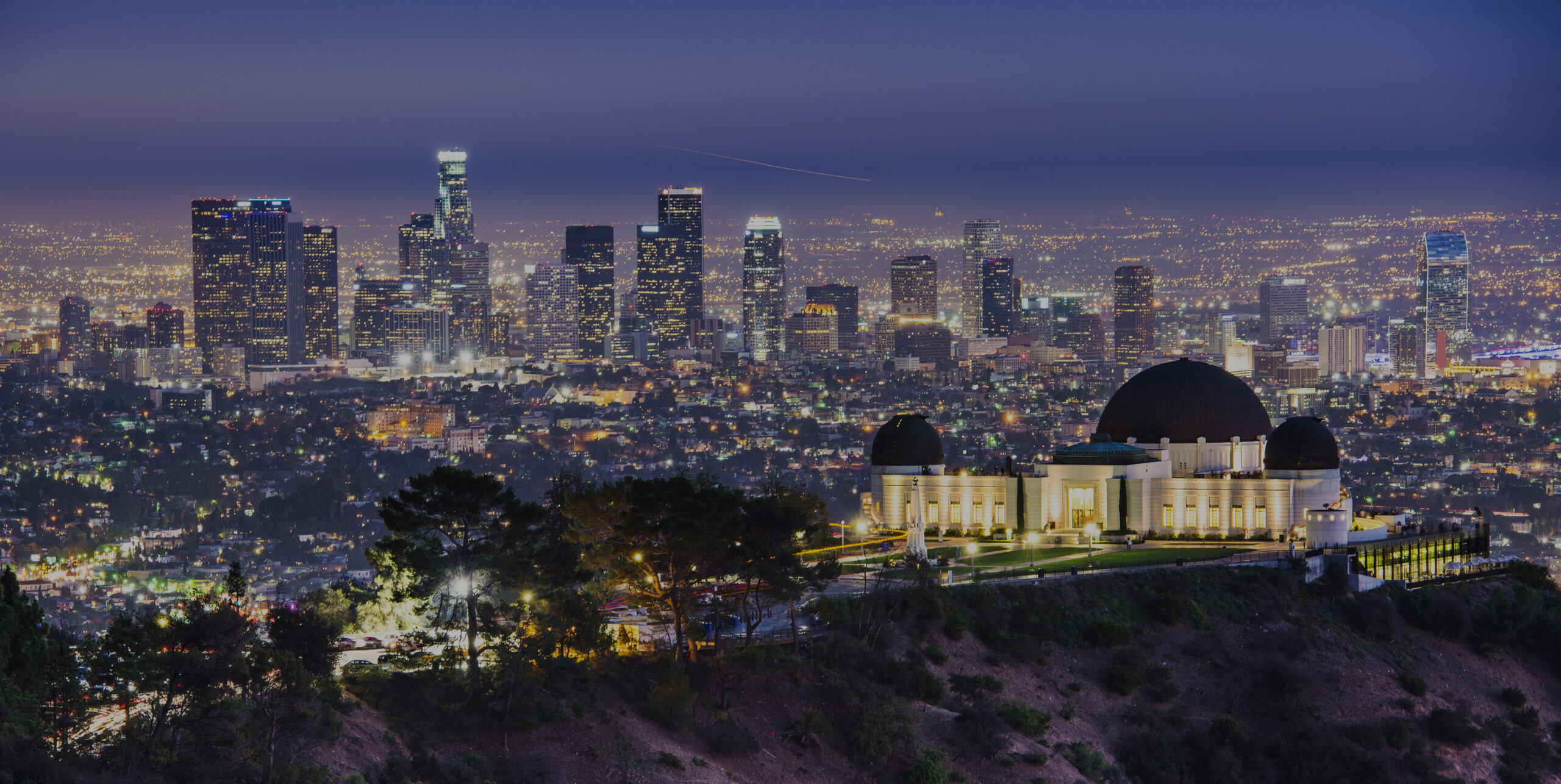 Griffith Obervatory and Downtown Los Angeles, California, USA skyline at dawn.